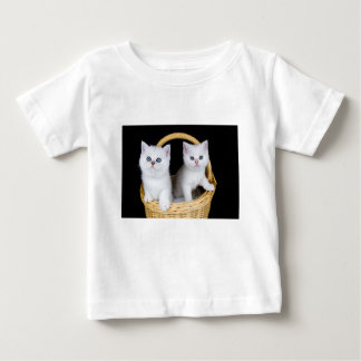Two white kittens in basket on black background.JP Baby T-Shirt