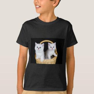 Two white kittens in basket on black background.JP T-Shirt