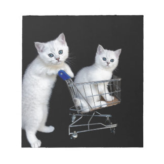 Two white kittens with shopping cart on black.JPG Notepad