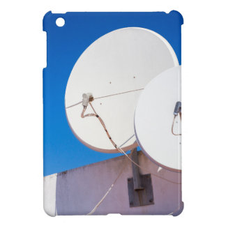 Two white satellite dishes on house wall iPad mini case