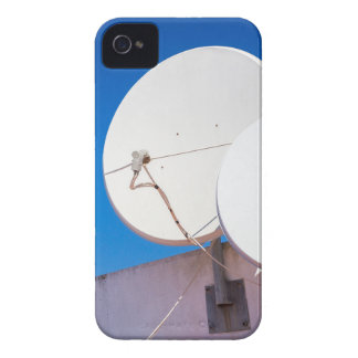 Two white satellite dishes on house wall iPhone 4 cases