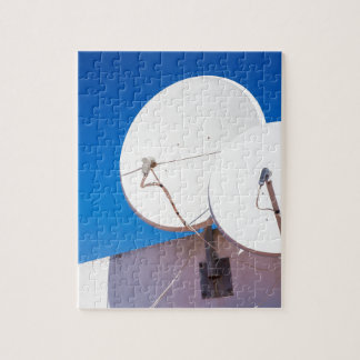 Two white satellite dishes on house wall jigsaw puzzle
