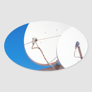 Two white satellite dishes on house wall oval sticker