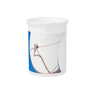Two white satellite dishes on house wall pitcher