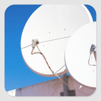 Two white satellite dishes on house wall square sticker