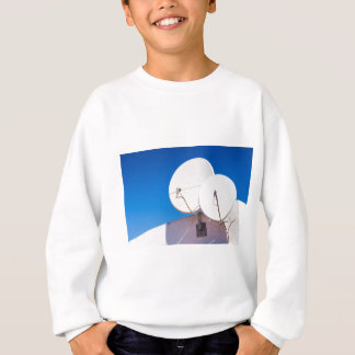Two white satellite dishes on house wall sweatshirt