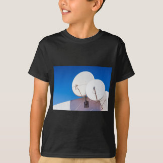 Two white satellite dishes on house wall T-Shirt