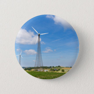 Two windmills in rural area with blue sky 6 cm round badge