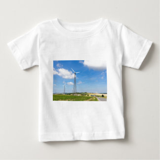 Two windmills in rural area with blue sky baby T-Shirt