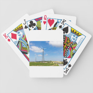 Two windmills in rural area with blue sky bicycle playing cards