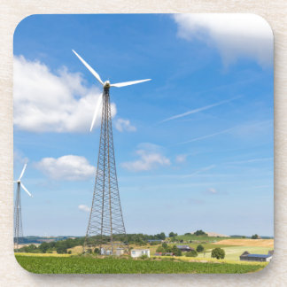 Two windmills in rural area with blue sky coaster