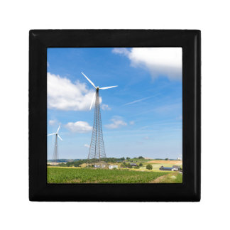 Two windmills in rural area with blue sky gift box