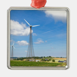 Two windmills in rural area with blue sky metal ornament