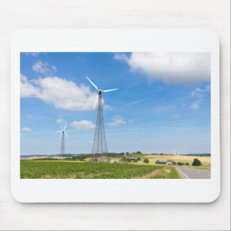 Two windmills in rural area with blue sky mouse pad
