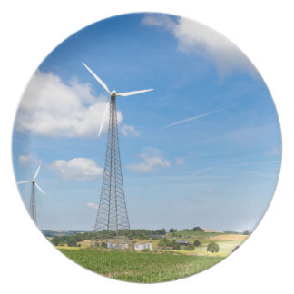 Two windmills in rural area with blue sky party plate