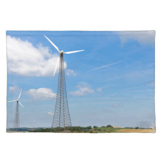 Two windmills in rural area with blue sky place mats