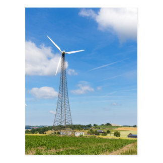 Two windmills in rural area with blue sky postcard