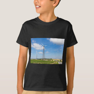 Two windmills in rural area with blue sky T-Shirt