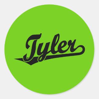 Tyler script logo in black round sticker