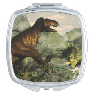 Tyrannosaurus rex fighting against styracosaurus vanity mirror