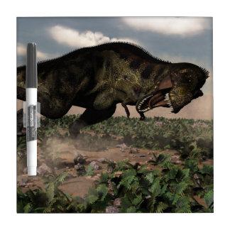 Tyrannosaurus rex roaring at a triceratops dry erase board
