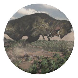 Tyrannosaurus rex roaring at a triceratops eraser