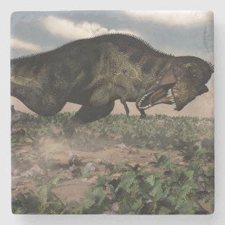 Tyrannosaurus rex roaring at a triceratops stone coaster