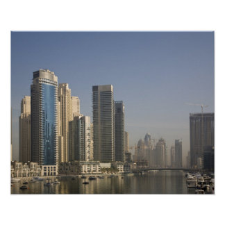 UAE, Dubai. Marina towers with boats at anchor. Poster