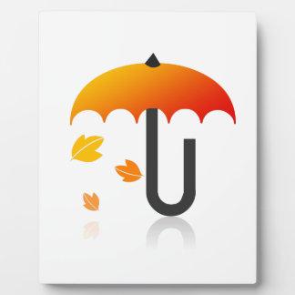 Umbrella and leaves plaque