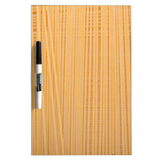 Uncooked spaghetti dry erase white board