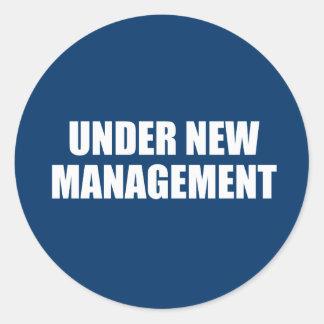 UNDER NEW MANAGEMENT ROUND STICKER