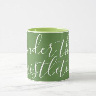 UNDER THE MISTLETOE - white on green Mug