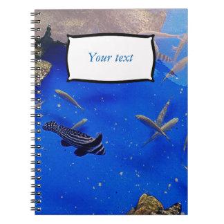 Underwater world clown fish swimming in the sea notebook