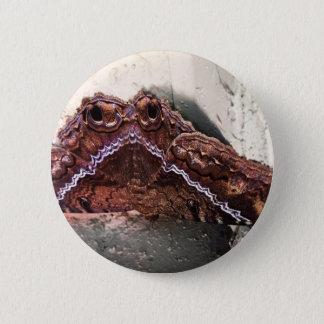 Upside down moth 6 cm round badge