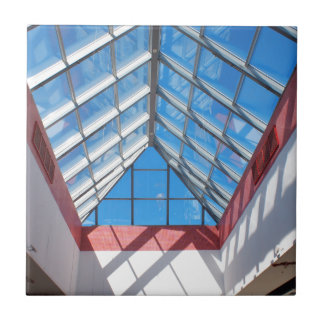 Upward view on the triangular glass roof tile