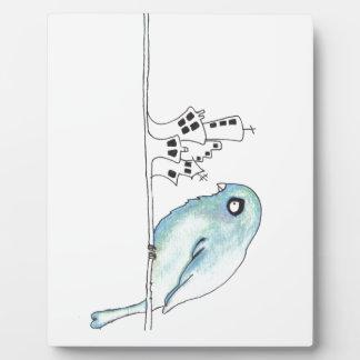 Urban blue bird on a wire display plaque