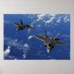 US Air Force F-22 Raptors in flight near Guam