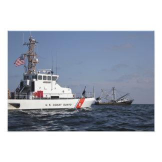US Coast Guard Cutter Marlin patrols the waters Photograph