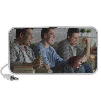 USA, New Jersey, Jersey City, three men watching 2 Speaker