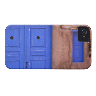 USA, New Mexico, Santa Fe. View of blue door and Blackberry Bold Cases