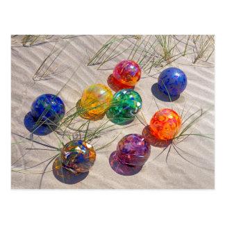 USA, Oregon. Colorful Glass Floats On Sand Dune Postcard
