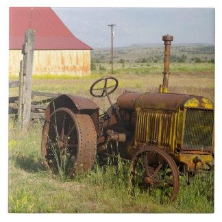 USA, Oregon, Shaniko. Rusty vintage tractor in Ceramic Tile