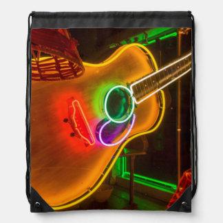 USA, Texas, Austin. Neon Guitar At Blackmail Drawstring Backpacks