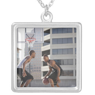 USA, Utah, Salt Lake City, two young men playing Silver Plated Necklace