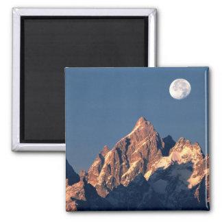 USA, Wyoming, Grand Teton NP. A full moon sets Square Magnet