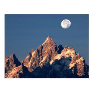 USA, Wyoming, Grand Teton NP. A full moon sets Postcard