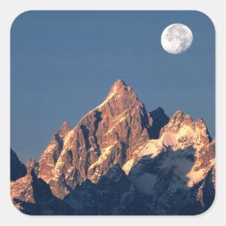 USA, Wyoming, Grand Teton NP. A full moon sets Sticker