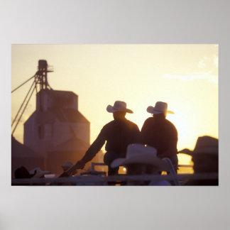 USA, Wyoming, Pine Bluffs. Two men shake Poster