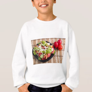 Useful and natural vegetable salad of tomato sweatshirt