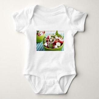 Useful vegetarian salad with raw tomatoes baby bodysuit